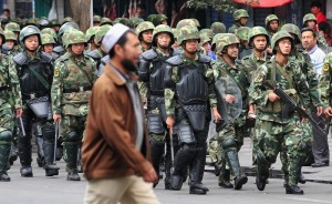 Armed Chinese soldiers march on patrol a